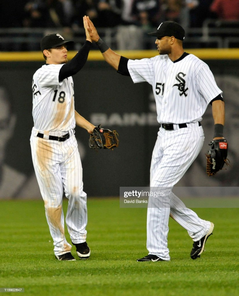 Brent Lillibridge # 18 of the Chicago White Sox and Alex Rios clelebrate the Sox victory against the Oakland Athletics on June 11, 2011 at U.S. Cellular Field in Chicago, Illinois. The Sox defeated the Athletics 3-2