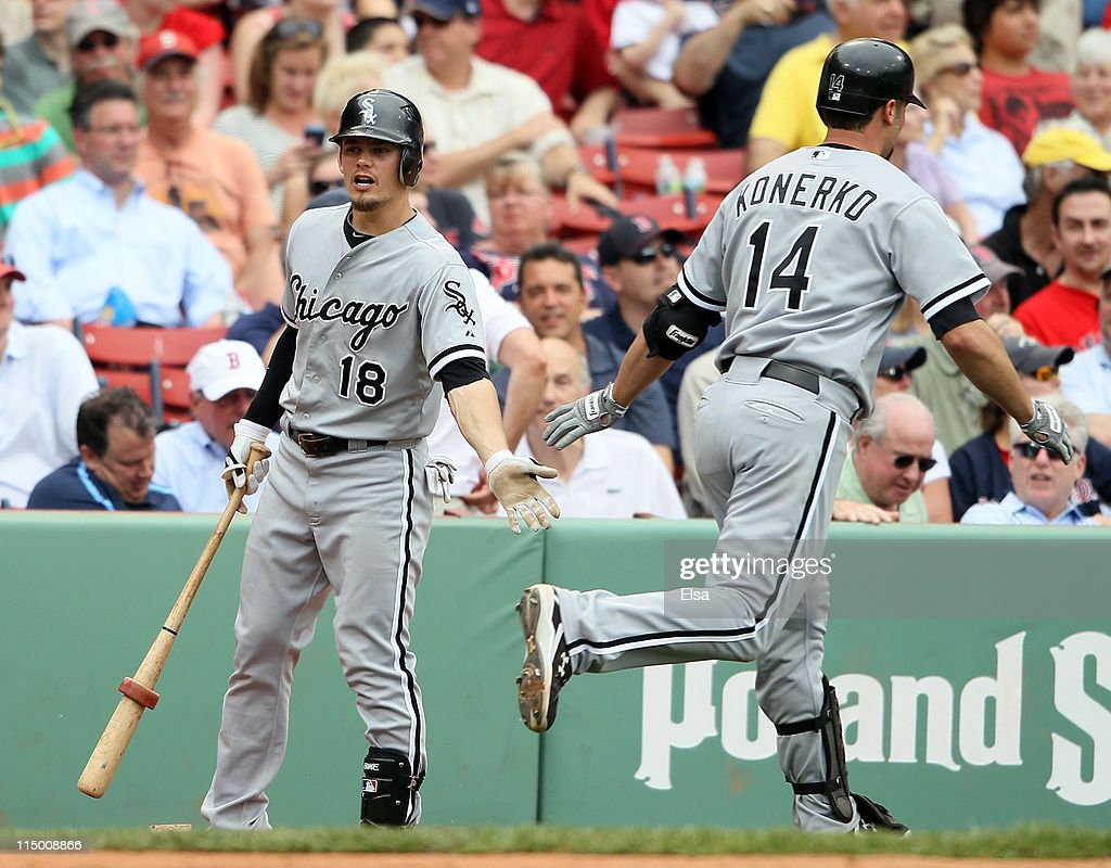 <a gi-track='captionPersonalityLinkClicked' href=/galleries/search?phrase=Brent+Lillibridge&family=editorial&specificpeople=4164757 ng-click='$event.stopPropagation()'>Brent Lillibridge</a> #18 of the Chicago White Sox congratulates teammate <a gi-track='captionPersonalityLinkClicked' href=/galleries/search?phrase=Paul+Konerko&family=editorial&specificpeople=203327 ng-click='$event.stopPropagation()'>Paul Konerko</a> #14 after he hits a a two run homer in the ninth inning against the Boston Red Sox on June 1, 2011 at Fenway Park in Boston, Massachusetts.
