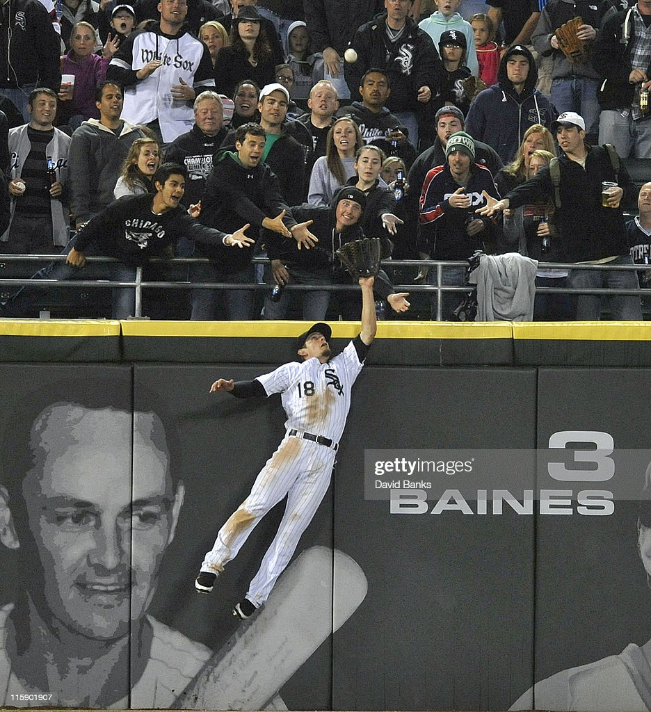 <a gi-track='captionPersonalityLinkClicked' href=/galleries/search?phrase=Brent+Lillibridge&family=editorial&specificpeople=4164757 ng-click='$event.stopPropagation()'>Brent Lillibridge</a> # 18 of the Chicago White Sox robs Coco Crisp of the Oakland Athletics of a 2-run homer in the eighth inning on June 11, 2011 at U.S. Cellular Field in Chicago, Illinois.