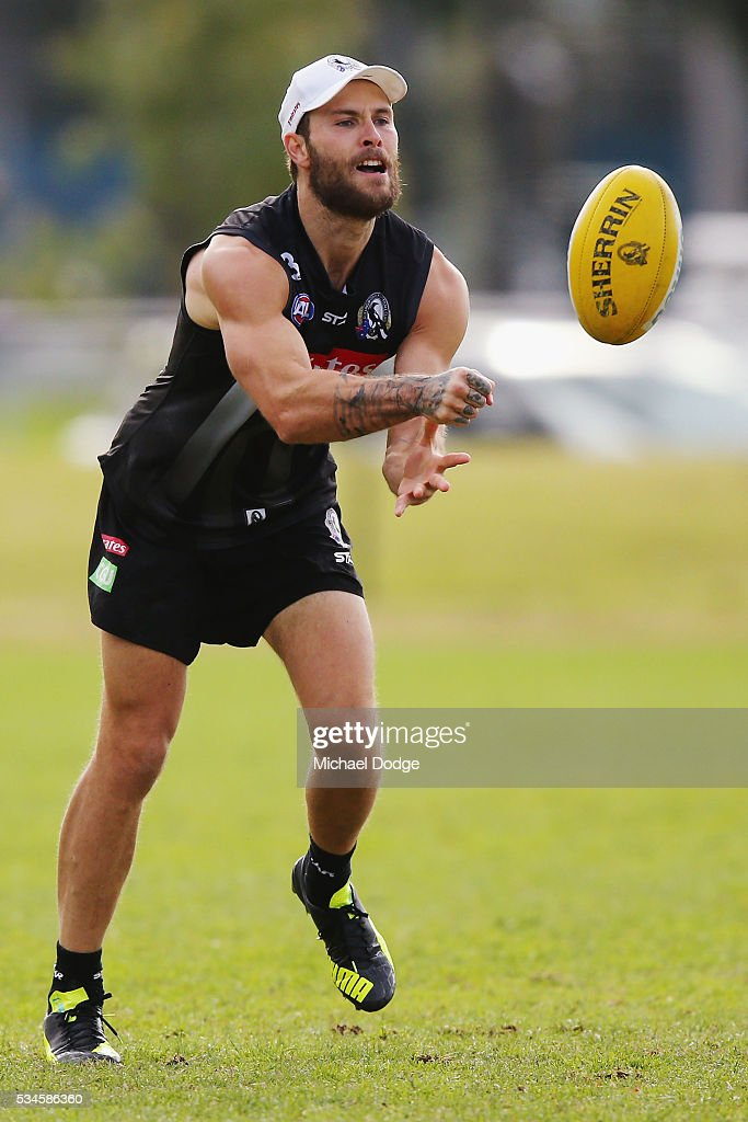 Brent Macaffer of the Magpies handballs during a Collingwood Magpies AFL training session on May 27, 2016 in Melbourne, Australia.