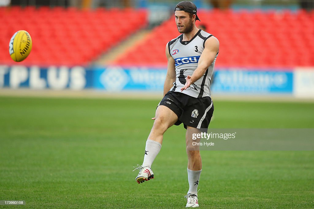 Brent Maccaffer kicks during a Collingwood Magpies AFL training session at Metricon Stadium on July 19, 2013 in Gold Coast, Australia.