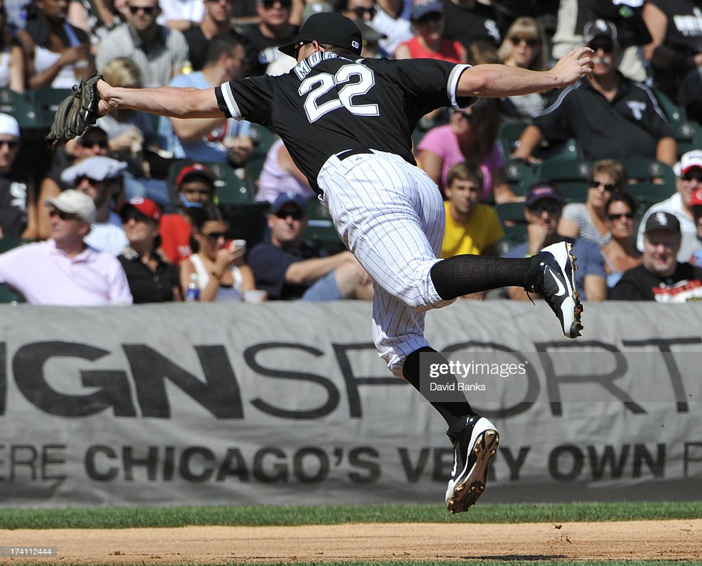 Brent Morel #22 of the Chicago White Sox makes a leaping catch on Andrelton Simmons #19 of the Atlanta Braves during the second inning on July 20, 2013 at U.S. Cellular Field in Chicago, Illinois.