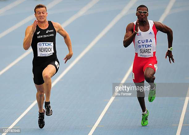 Brent Newdick of New Zealand and Leonel Suarez of Cuba compete in the 100 metres in the men's decathlon during day one of the 13th IAAF World...