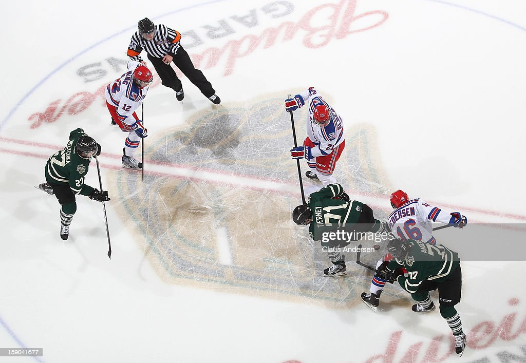 Brent Pedersen #16 of the Kitchener Rangers battles for puck control with Chris Tierney #71 of the London Knights in an OHL game on January 5, 2013 at the Budweiser Gardens in London, Canada. The Knights defeated the Rangers 3-2.