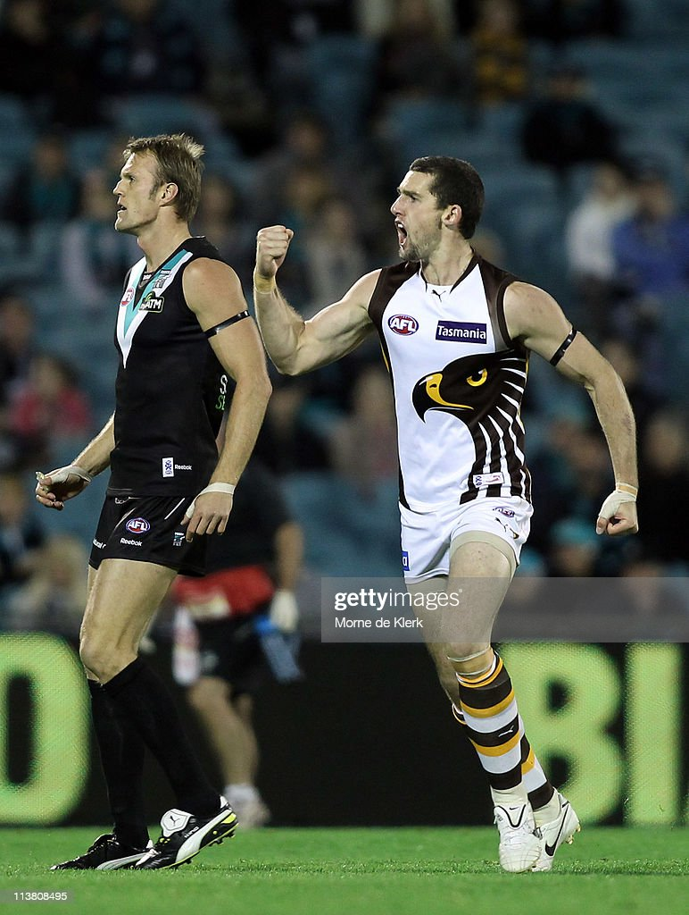 Brent Renouf of the Hawks celebrates after kicking a goal as Dean Brogan of the Power looks on during the round seven AFL match between Port Adelaide...