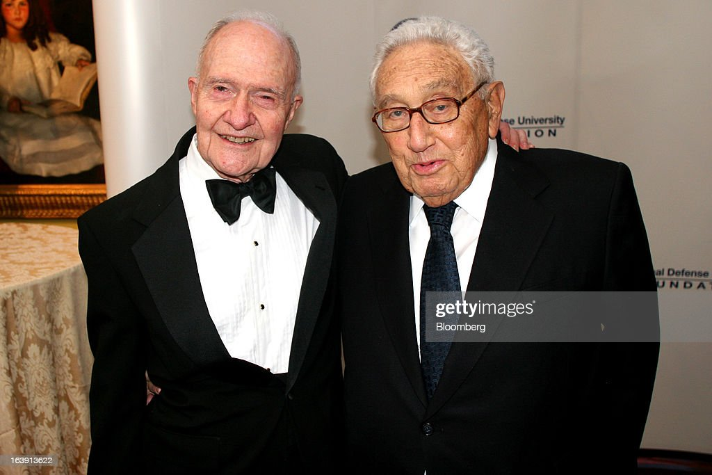 Brent Scowcroft, former U.S. national security adviser, left, and Henry Kissinger, former U.S. secretary of state, attend a dinner at the Ritz-Carlton hotel in Washington, D.C., U.S., on Wednesday, March 13, 2013. The event was a tribute dinner where Scowcroft received the Lifetime International Statesman and Business Advocate Award from the National Defense University Foundation. Photographer: Stephanie Green/Bloomberg via Getty Images