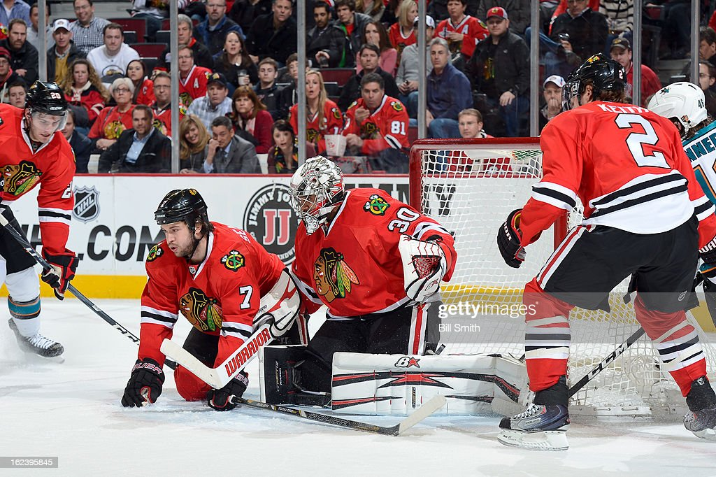 <a gi-track='captionPersonalityLinkClicked' href=/galleries/search?phrase=Brent+Seabrook&family=editorial&specificpeople=638862 ng-click='$event.stopPropagation()'>Brent Seabrook</a> #7 and goalie <a gi-track='captionPersonalityLinkClicked' href=/galleries/search?phrase=Ray+Emery&family=editorial&specificpeople=218109 ng-click='$event.stopPropagation()'>Ray Emery</a> #30 of the Chicago Blackhawks block the net during the NHL game against the San Jose Sharks on February 22, 2013 at the United Center in Chicago, Illinois.
