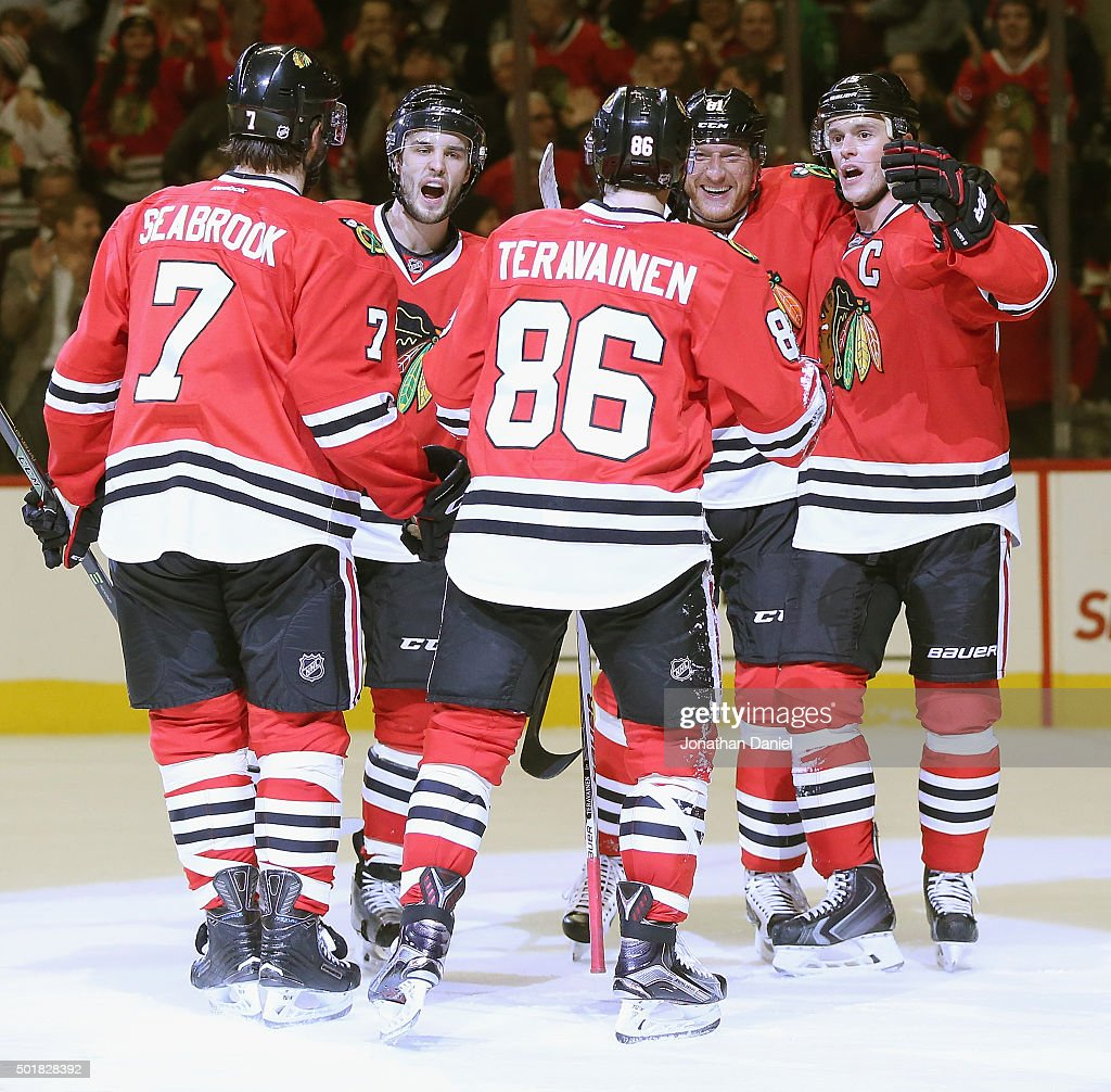 <a gi-track='captionPersonalityLinkClicked' href=/galleries/search?phrase=Brent+Seabrook&family=editorial&specificpeople=638862 ng-click='$event.stopPropagation()'>Brent Seabrook</a> #7, <a gi-track='captionPersonalityLinkClicked' href=/galleries/search?phrase=Niklas+Hjalmarsson&family=editorial&specificpeople=2006442 ng-click='$event.stopPropagation()'>Niklas Hjalmarsson</a> #4, <a gi-track='captionPersonalityLinkClicked' href=/galleries/search?phrase=Marian+Hossa&family=editorial&specificpeople=202233 ng-click='$event.stopPropagation()'>Marian Hossa</a> #81 and <a gi-track='captionPersonalityLinkClicked' href=/galleries/search?phrase=Jonathan+Toews&family=editorial&specificpeople=537799 ng-click='$event.stopPropagation()'>Jonathan Toews</a> #19 of the Chicago Blackhawks move to congratulate teammate Teuvo Teravainen #86 after Teravainen scored a second period goal against the Edmonton Oilers at the United Center on December 17, 2015 in Chicago, Illinois.