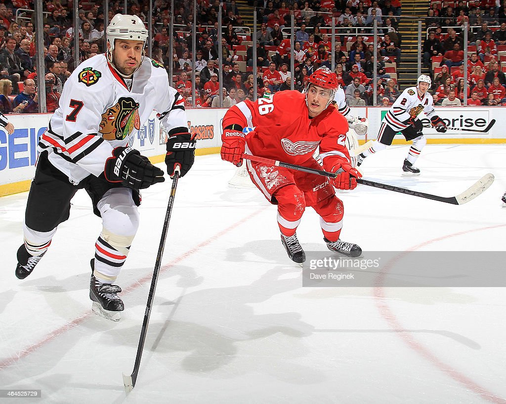 <a gi-track='captionPersonalityLinkClicked' href=/galleries/search?phrase=Brent+Seabrook&family=editorial&specificpeople=638862 ng-click='$event.stopPropagation()'>Brent Seabrook</a> #7 of the Chicago Blackhawks and Tomas Jurco #26 of the Detroit Red Wings race for the puck during an NHL game on January 22, 2014 at Joe Louis Arena in Detroit, Michigan.