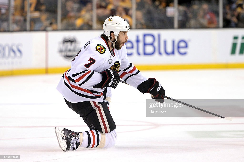 <a gi-track='captionPersonalityLinkClicked' href=/galleries/search?phrase=Brent+Seabrook&family=editorial&specificpeople=638862 ng-click='$event.stopPropagation()'>Brent Seabrook</a> #7 of the Chicago Blackhawks celebrates after scoring the game winning goal against the Boston Bruins in overtime in Game Four of the 2013 NHL Stanley Cup Final at TD Garden on June 19, 2013 in Boston, Massachusetts.