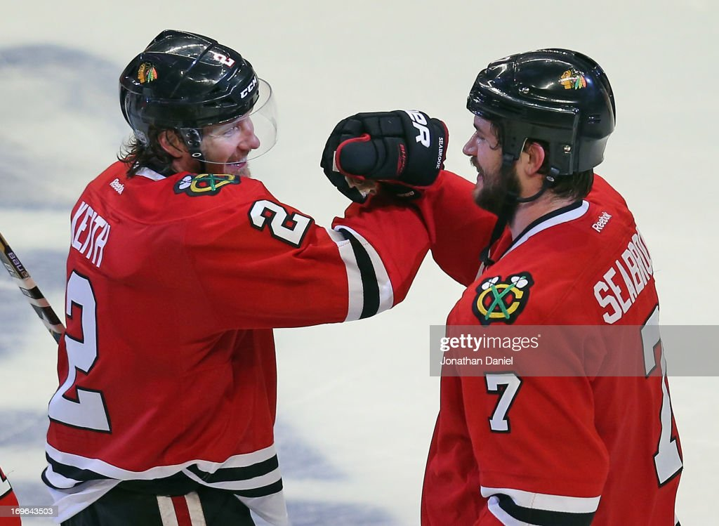 <a gi-track='captionPersonalityLinkClicked' href=/galleries/search?phrase=Brent+Seabrook&family=editorial&specificpeople=638862 ng-click='$event.stopPropagation()'>Brent Seabrook</a> #7 of the Chicago Blackhawks celebrates with <a gi-track='captionPersonalityLinkClicked' href=/galleries/search?phrase=Duncan+Keith&family=editorial&specificpeople=4194433 ng-click='$event.stopPropagation()'>Duncan Keith</a> #2 after a win against the Detroit Red Wings in Game Seven of the Western Conference Semifinals during the 2013 NHL Stanley Cup Playoffs at the United Center on May 29, 2013 in Chicago, Illinois. The Blackhawks defeated the Red Wings 2-1 in overtime.