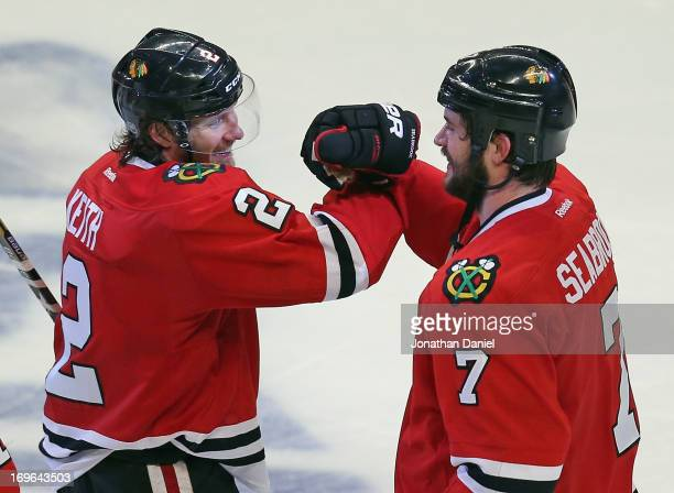 Brent Seabrook of the Chicago Blackhawks celebrates with Duncan Keith after a win against the Detroit Red Wings in Game Seven of the Western...