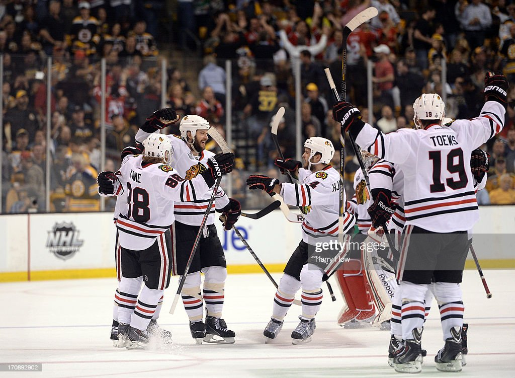 <a gi-track='captionPersonalityLinkClicked' href=/galleries/search?phrase=Brent+Seabrook&family=editorial&specificpeople=638862 ng-click='$event.stopPropagation()'>Brent Seabrook</a> #7 of the Chicago Blackhawks celebrates with Patrick Kane #88, <a gi-track='captionPersonalityLinkClicked' href=/galleries/search?phrase=Niklas+Hjalmarsson&family=editorial&specificpeople=2006442 ng-click='$event.stopPropagation()'>Niklas Hjalmarsson</a> #4 and <a gi-track='captionPersonalityLinkClicked' href=/galleries/search?phrase=Jonathan+Toews&family=editorial&specificpeople=537799 ng-click='$event.stopPropagation()'>Jonathan Toews</a> #19 after scoring the game winning goal in overtime against the Boston Bruins in Game Four of the 2013 NHL Stanley Cup Final at TD Garden on June 19, 2013 in Boston, Massachusetts.