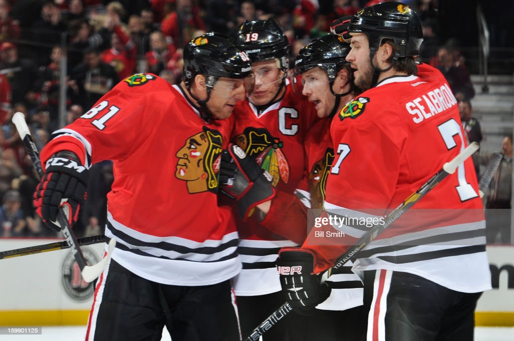 Brent Seabrook #7 of the Chicago Blackhawks celebrates with teammates Marian Hossa #81, Jonathan Toews #19 and Duncan Keith #2 after scoring in the second period against the St. Louis Blues on January 22, 2013 at the United Center in Chicago, Illinois.