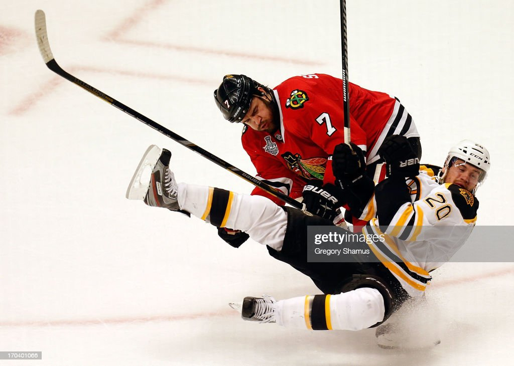<a gi-track='captionPersonalityLinkClicked' href=/galleries/search?phrase=Brent+Seabrook&family=editorial&specificpeople=638862 ng-click='$event.stopPropagation()'>Brent Seabrook</a> #7 of the Chicago Blackhawks checks <a gi-track='captionPersonalityLinkClicked' href=/galleries/search?phrase=Daniel+Paille&family=editorial&specificpeople=706561 ng-click='$event.stopPropagation()'>Daniel Paille</a> #20 of the Boston Bruins to the ice in Game One of the 2013 NHL Stanley Cup Final at United Center on June 12, 2013 in Chicago, Illinois.