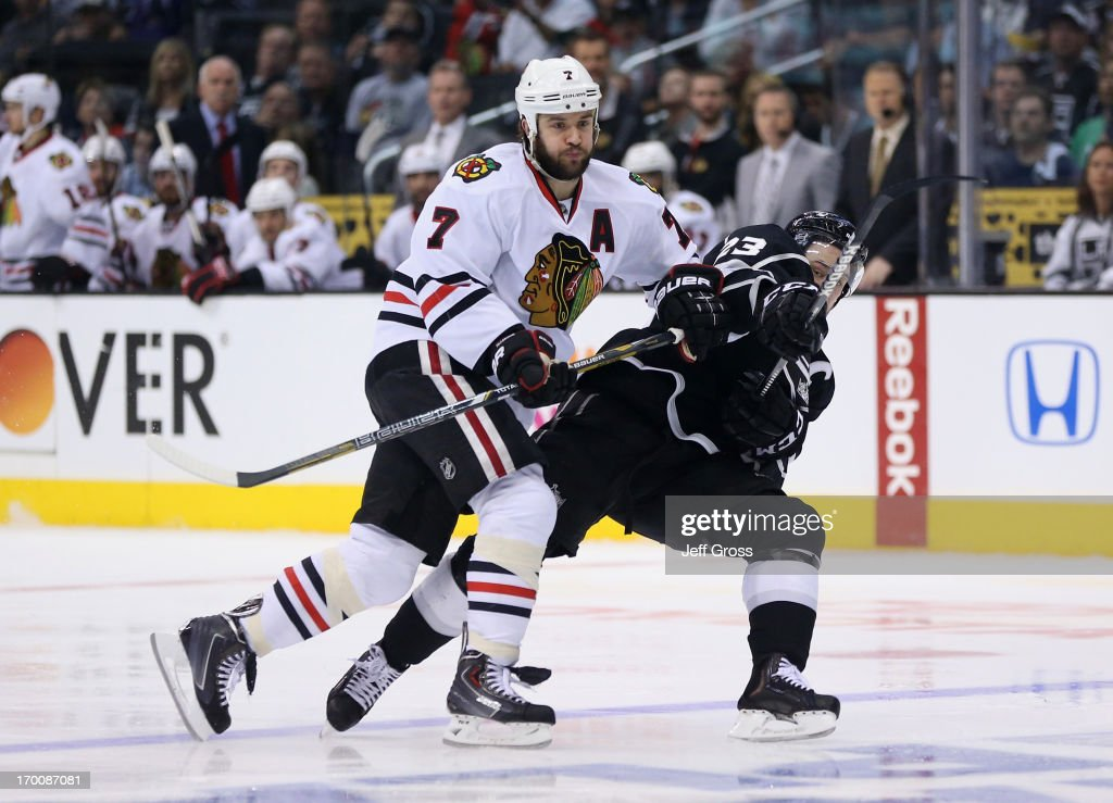 <a gi-track='captionPersonalityLinkClicked' href=/galleries/search?phrase=Brent+Seabrook&family=editorial&specificpeople=638862 ng-click='$event.stopPropagation()'>Brent Seabrook</a> #7 of the Chicago Blackhawks checks Dustin Brown #23 of the Los Angeles Kings near the blueline in the second period of Game Four of the Western Conference Final during the 2013 NHL Stanley Cup Playoffs at Staples Center on June 6, 2013 in Los Angeles, California.The Blackhawks defeated the Kings 3-2.