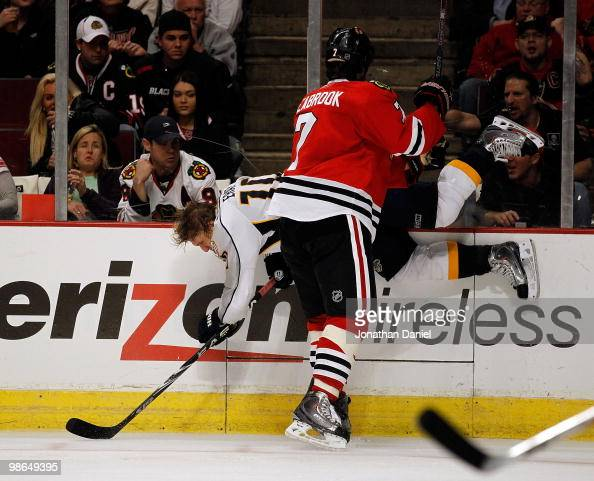 Brent Seabrook of the Chicago Blackhawks checks Martin Erat of the Nashville Predators into the boards in Game Five of the Western Conference...