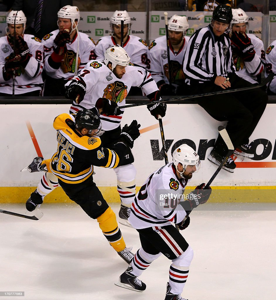Brent Seabrook #7 of the Chicago Blackhawks collides with David Krejci #46 of the Boston Bruins in Game Three of the 2013 NHL Stanley Cup Final at TD Garden on June 17, 2013 in Boston, Massachusetts.