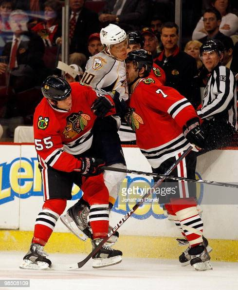 Brent Seabrook of the Chicago Blackhawks collides with Martin Erat of the Nashville Predators as Ben Eager tries to avoid contact in Game One of the...