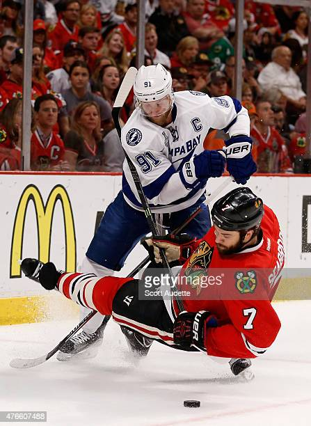 Brent Seabrook of the Chicago Blackhawks falls to the ice after colliding with Steven Stamkos of the Tampa Bay Lightning during the first period of...