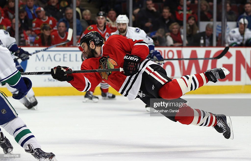 <a gi-track='captionPersonalityLinkClicked' href=/galleries/search?phrase=Brent+Seabrook&family=editorial&specificpeople=638862 ng-click='$event.stopPropagation()'>Brent Seabrook</a> #7 of the Chicago Blackhawks goes airbourne as he shots against the Vancouver Canucks at the United Center on February 11, 2015 in Chicago, Illinois. The Canucks defeated the Blackhawks 5-4 in overtime.