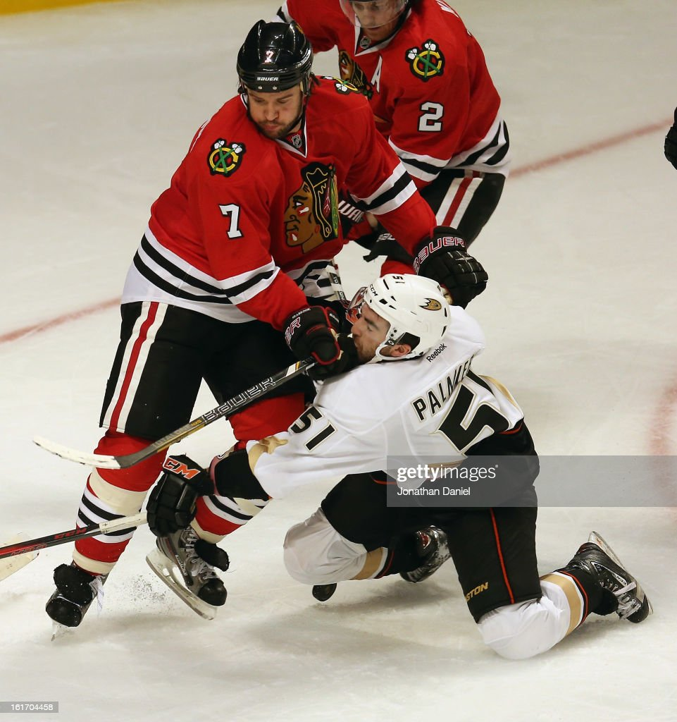 <a gi-track='captionPersonalityLinkClicked' href=/galleries/search?phrase=Brent+Seabrook&family=editorial&specificpeople=638862 ng-click='$event.stopPropagation()'>Brent Seabrook</a> #7 of the Chicago Blackhawks hits Kyle Palmieri #51 of the Anaheim Ducks in the face at the United Center on February 12, 2013 in Chicago, Illinois. The Ducks defeated the Blackhawks 3-2 in a shootout.