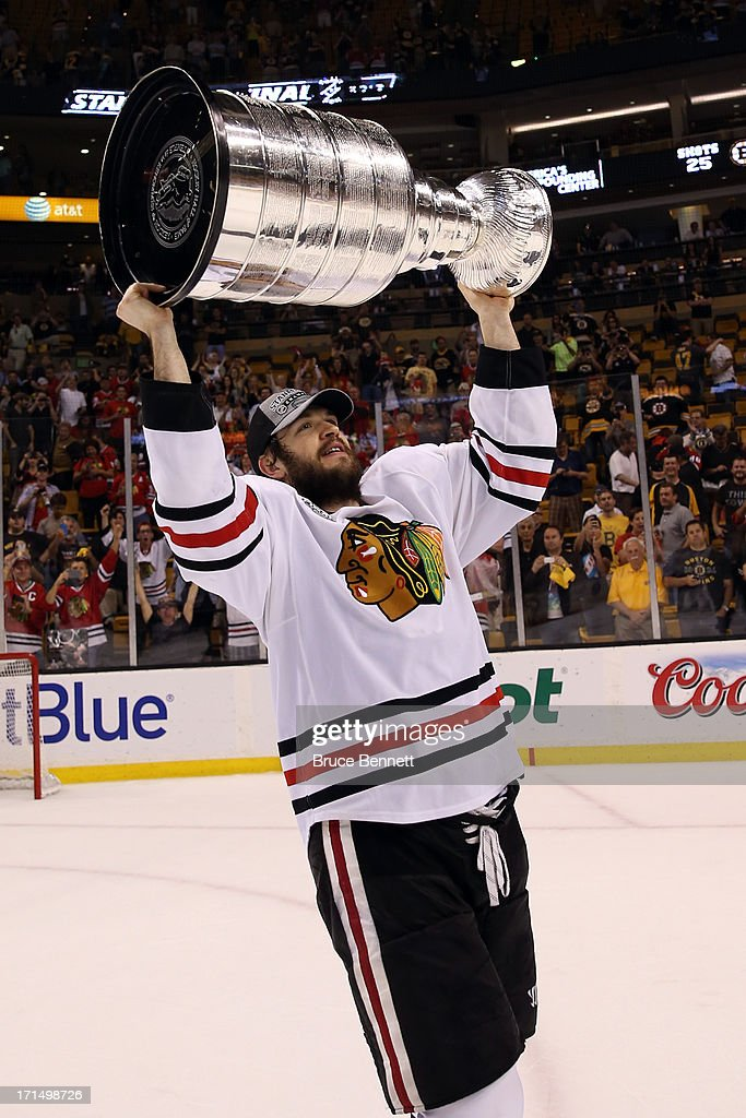 Brent Seabrook #7 of the Chicago Blackhawks hoists the Stanley Cup Trophy after defeating the Boston Bruins in Game Six of the 2013 NHL Stanley Cup Final at TD Garden on June 24, 2013 in Boston, Massachusetts. The Chicago Blackhawks defeated the Boston Bruins 3-2.