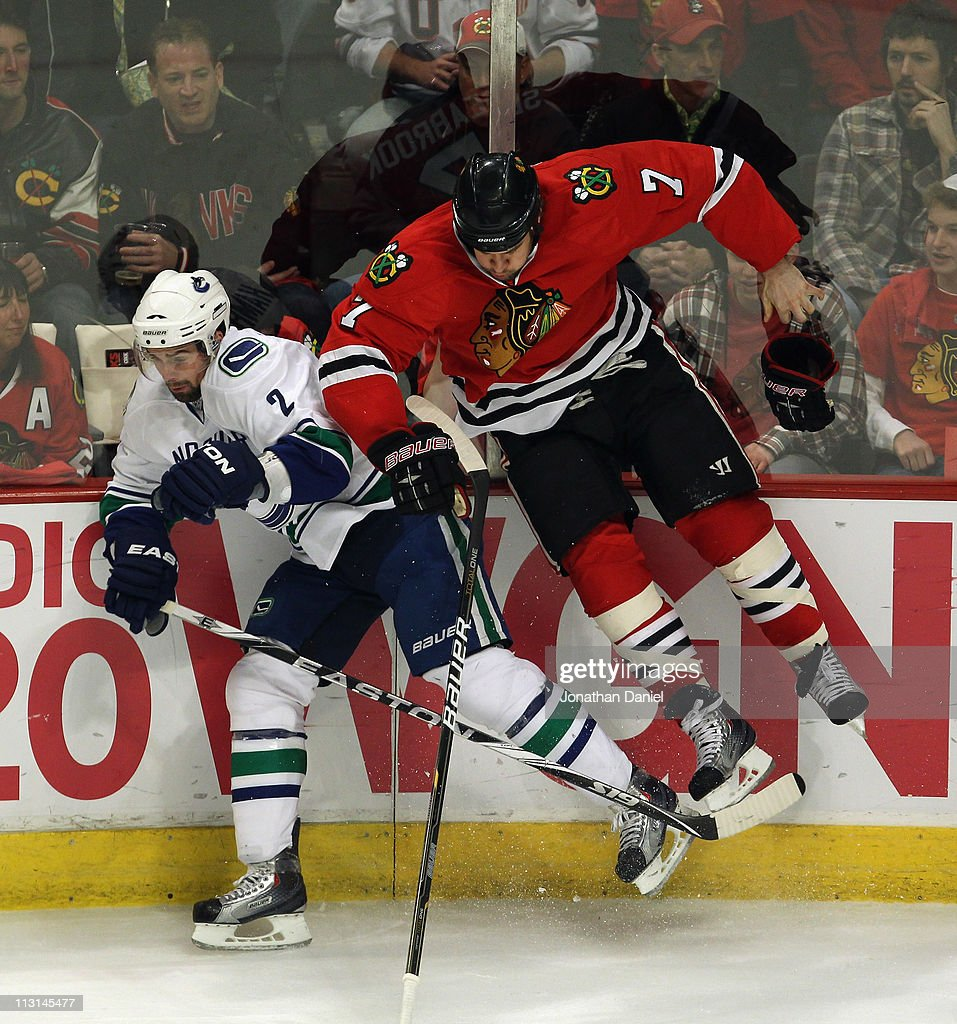 <a gi-track='captionPersonalityLinkClicked' href=/galleries/search?phrase=Brent+Seabrook&family=editorial&specificpeople=638862 ng-click='$event.stopPropagation()'>Brent Seabrook</a> #7 of the Chicago Blackhawks looses his stick and glove after being hit by <a gi-track='captionPersonalityLinkClicked' href=/galleries/search?phrase=Dan+Hamhuis&family=editorial&specificpeople=204213 ng-click='$event.stopPropagation()'>Dan Hamhuis</a> #2 of the Vancouver Canucks in Game Six of the Western Conference Quarterfinals during the 2011 NHL Stanley Cup Playoffs at the United Center on April 24, 2011 in Chicago, Illinois.