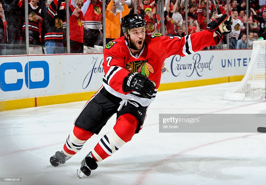 <a gi-track='captionPersonalityLinkClicked' href=/galleries/search?phrase=Brent+Seabrook&family=editorial&specificpeople=638862 ng-click='$event.stopPropagation()'>Brent Seabrook</a> #7 of the Chicago Blackhawks reacts after scoring the game-winning goal in overtime against the Detroit Red Wings to take the series in Game Seven of the Western Conference Semifinals during the 2013 Stanley Cup Playoffs at the United Center on May 29, 2013 in Chicago, Illinois.