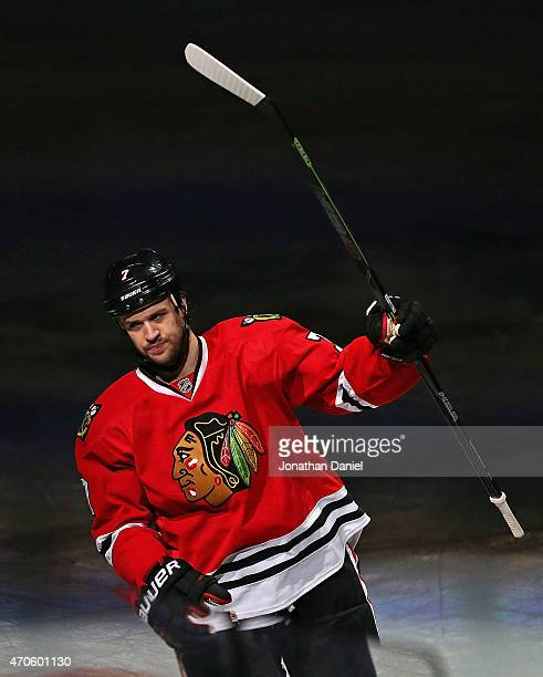 Brent Seabrook of the Chicago Blackhawks salutes the crowd after scoring the game winning goal in triple overtime against the Nashville Predators in...