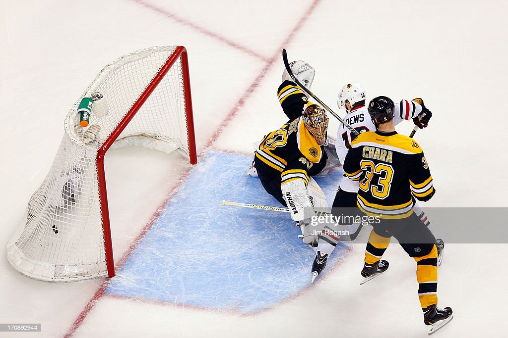 Brent Seabrook #7 of the Chicago Blackhawks (not pictured) scores a game winning goal against <a gi-track='captionPersonalityLinkClicked' href=/galleries/search?phrase=Tuukka+Rask&family=editorial&specificpeople=716723 ng-click='$event.stopPropagation()'>Tuukka Rask</a> #40 of the Boston Bruins in overtime as <a gi-track='captionPersonalityLinkClicked' href=/galleries/search?phrase=Jonathan+Toews&family=editorial&specificpeople=537799 ng-click='$event.stopPropagation()'>Jonathan Toews</a> #19 and <a gi-track='captionPersonalityLinkClicked' href=/galleries/search?phrase=Zdeno+Chara&family=editorial&specificpeople=203177 ng-click='$event.stopPropagation()'>Zdeno Chara</a> #33 looks on in Game Four of the 2013 NHL Stanley Cup Final at TD Garden on June 19, 2013 in Boston, Massachusetts.