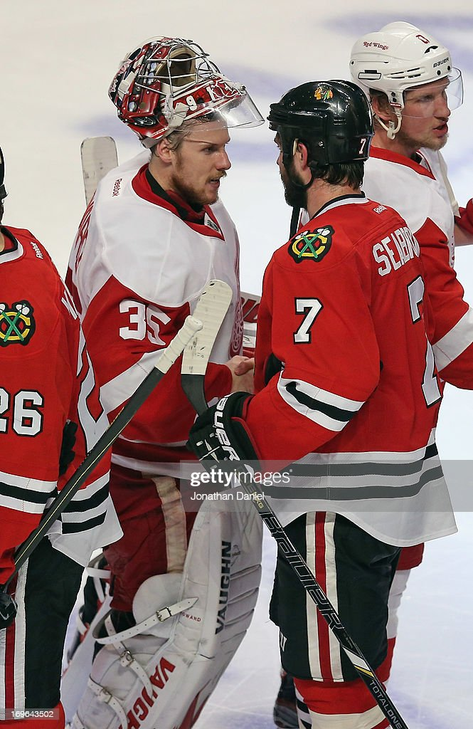 <a gi-track='captionPersonalityLinkClicked' href=/galleries/search?phrase=Brent+Seabrook&family=editorial&specificpeople=638862 ng-click='$event.stopPropagation()'>Brent Seabrook</a> #7 of the Chicago Blackhawks shakes hands with <a gi-track='captionPersonalityLinkClicked' href=/galleries/search?phrase=Jimmy+Howard&family=editorial&specificpeople=2118637 ng-click='$event.stopPropagation()'>Jimmy Howard</a> #35 of the Detroit Red Wings after a Blackhawk win in Game Seven of the Western Conference Semifinals during the 2013 NHL Stanley Cup Playoffs at the United Center on May 29, 2013 in Chicago, Illinois. The Blackhawks defeated the Red Wings 2-1 in overtime.