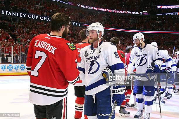 Brent Seabrook of the Chicago Blackhawks shakes hands with Steven Stamkos of the Tampa Bay Lightning after the Blackhawks won Game Six by a score of...
