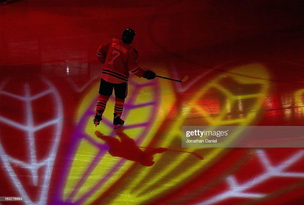 <a gi-track='captionPersonalityLinkClicked' href=/galleries/search?phrase=Brent+Seabrook&family=editorial&specificpeople=638862 ng-click='$event.stopPropagation()'>Brent Seabrook</a> #7 of the Chicago Blackhawks skates during player introductions before a game against the Colorado Avalanche at the United Center on March 6, 2013 in Chicago, Illinois.