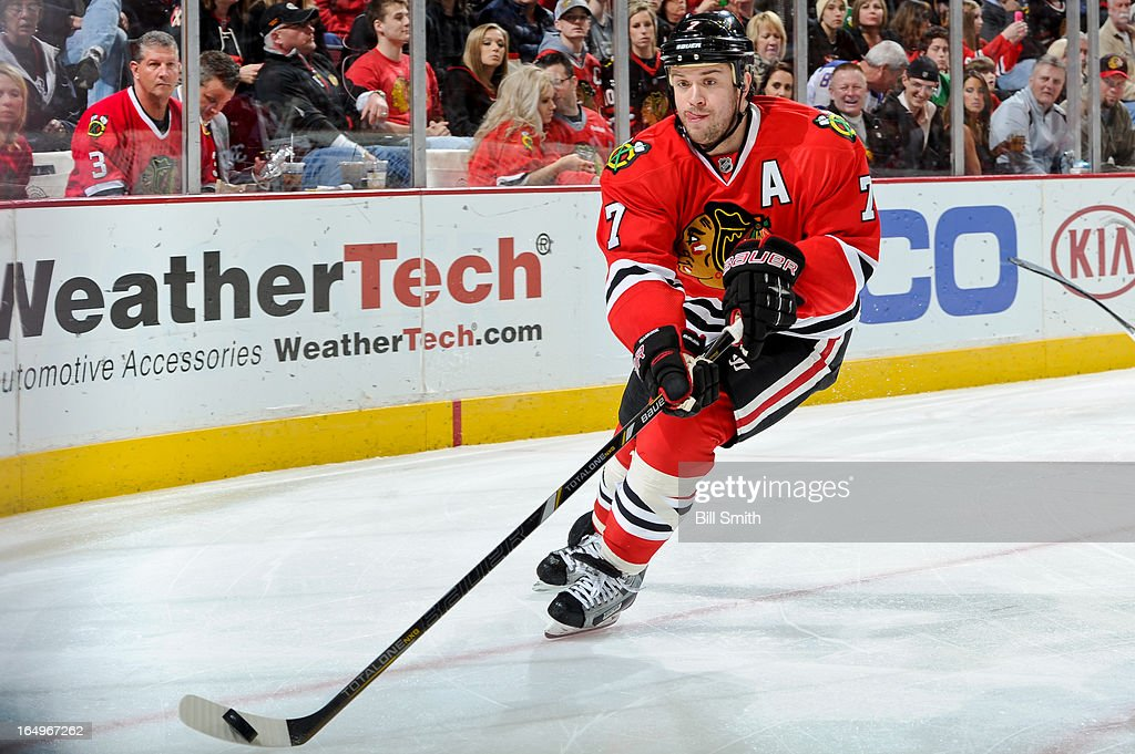 <a gi-track='captionPersonalityLinkClicked' href=/galleries/search?phrase=Brent+Seabrook&family=editorial&specificpeople=638862 ng-click='$event.stopPropagation()'>Brent Seabrook</a> #7 of the Chicago Blackhawks takes control of the puck during the NHL game against the Anaheim Ducks on March 29, 2013 at the United Center in Chicago, Illinois.