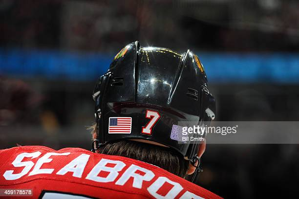 Brent Seabrook of the Chicago Blackhawks wears a helmet with the 'Hockey Fights Cancer' logo during the NHL game against the Tampa Bay Lightning on...