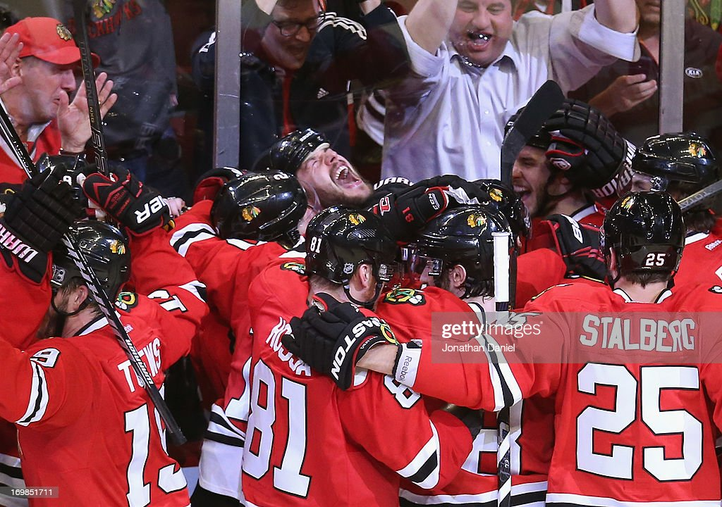 <a gi-track='captionPersonalityLinkClicked' href=/galleries/search?phrase=Brent+Seabrook&family=editorial&specificpeople=638862 ng-click='$event.stopPropagation()'>Brent Seabrook</a> #7 of the Chicago Blackhawks (center) yells as teammates join him in celebration after he scored the winning goal in overtime against against the Detroit Red Wings in Game Seven of the Western Conference Semifinals during the 2013 NHL Stanley Cup Playoffs at the United Center on May 29, 2013 in Chicago, Illinois. The Blackhawks defeated the Red Wings 2-1 in overtime.