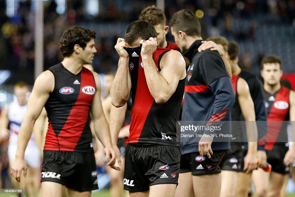 Brent Stanton of the Bombers pulls his jumper over his face after during the round 20 AFL match between the Essendon Bombers and the Adelaide Crows...