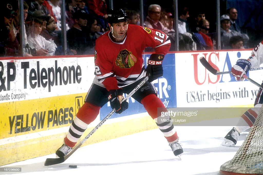<a gi-track='captionPersonalityLinkClicked' href=/galleries/search?phrase=Brent+Sutter&family=editorial&specificpeople=1045160 ng-click='$event.stopPropagation()'>Brent Sutter</a> #12 of the Chicago Black Hawks skates with the puck during a hockey game against the Washington Capitals on March 8, 1994 at USAir Arena in Landover, Maryland. The Capitals won 4-1.