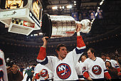 Brent Sutter of the New York Islanders hoists the Stanley Cup over his head after the Islanders defeated the Edmonton Oilers for the NHL championship...