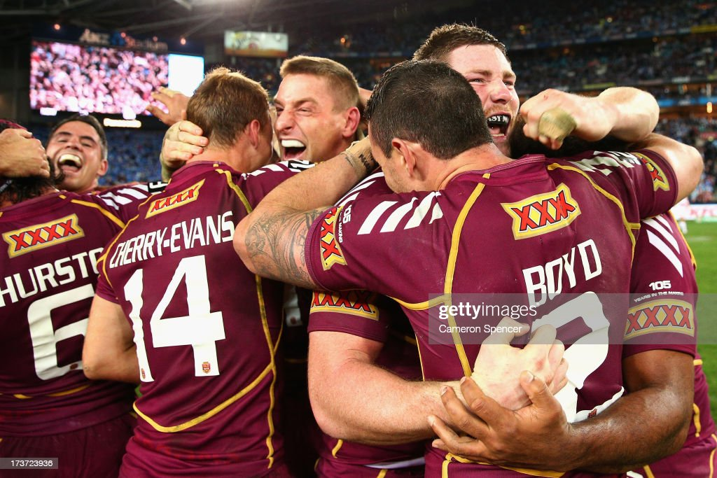 Brent Tate, Chris McQueen of the Maroons and team mates celebrate winning game three of the ARL State of Origin series between the New South Wales Blues and the Queensland Maroons at ANZ Stadium on July 17, 2013 in Sydney, Australia.