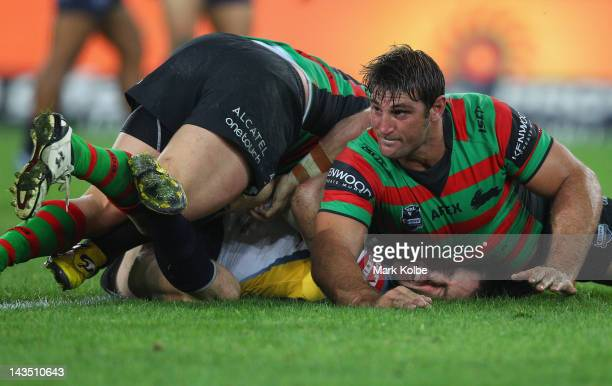 Brent Tate of the Cowboys is tackled by David Taylor of the Cowboys during the round eight NRL match between the South Sydney Rabbitohs and the North...