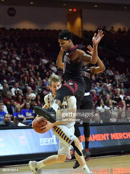 Brent Wrapp of the Cal State Bakersfield Roadrunners is fouled by Jemerrio Jones of the New Mexico State Aggies during the championship game of the...