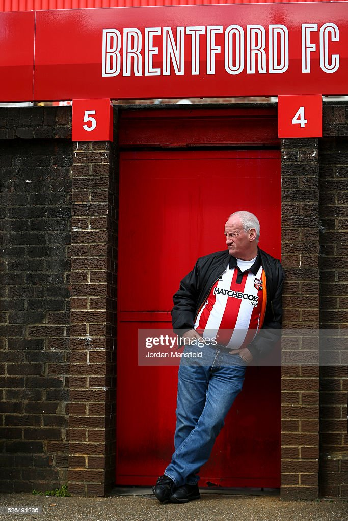 A Brentford fan waits outside the ground ahead of the Sky Bet Championship match between Brentford and Fulham at Griffin Park on April 30, 2016 in Brentford, England.