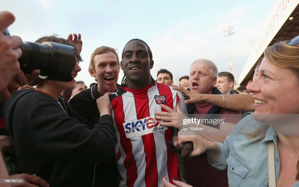 Brentford fans celebrates with <a gi-track='captionPersonalityLinkClicked' href=/galleries/search?phrase=Clayton+Donaldson&family=editorial&specificpeople=4141597 ng-click='$event.stopPropagation()'>Clayton Donaldson</a> after the npower League One Play Off Semi Final, Second Leg match between Brentford and Swindon at Griffin Park on May 5, 2013 in London, England.