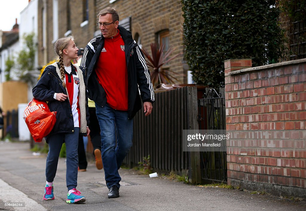 Brentford fans make their way to the ground ahead of the Sky Bet Championship match between Brentford and Fulham at Griffin Park on April 30, 2016 in Brentford, England.