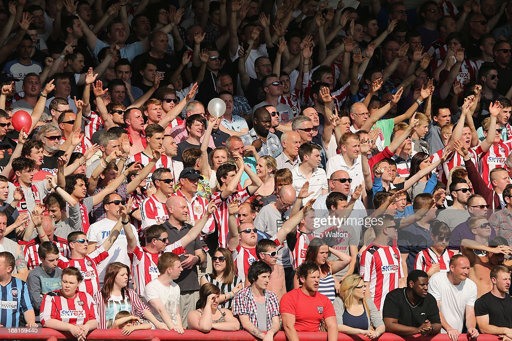 Brentford fans show their support during the npower League One Play Off Semi Final, Second Leg match between Brentford and Swindon Town at Griffin Park on May 6, 2013 in Brentford, England.