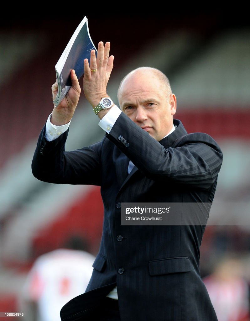 Brentford manager Uwe Rosler claps the home fans during the npower League One match between Brentford and Bournemouth at Griffin Park on January 01, 2013 in London England.