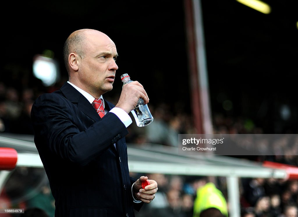 Brentford manager Uwe Rosler sips his water during the npower League One match between Brentford and Bournemouth at Griffin Park on January 01, 2013 in London England.