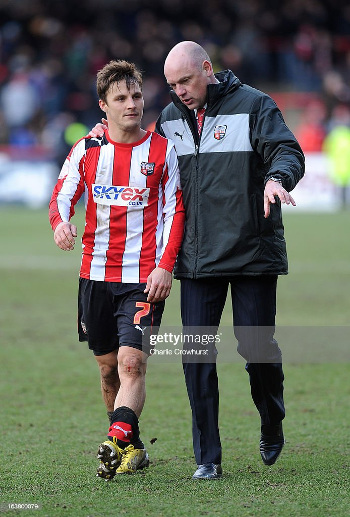 Brentford manager Uwe Rosler with goals score Sam Saunders at the end of the match in the npower League One match between Brentford and Preston North End at Griffin Park on March 16, 2013 in London, England,
